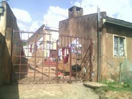 Build & rented plot for sale in Kitale town.