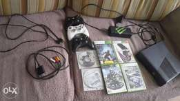 xbox with 3 remotes and 6 games.