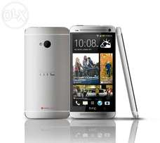 !! Brand new HTC one m7!! One yr warranty!!