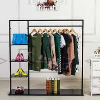 Shop fitting clothing stands for boutiques or retail stores.