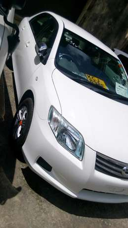 Toyota Axio metallic and Pearl white in colour,kcj. Mombasa Island - image 3