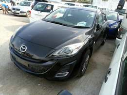 Mazda Axela hatchback KCM number 2010 model loaded with alloy rims,