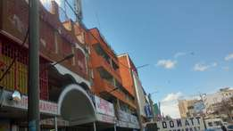 Land in town cbd with storey building income 2m 300m asking