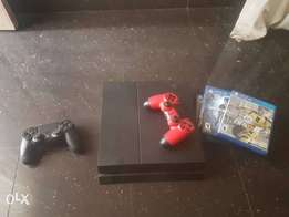 Ps4 with 2 pads and 3 game cds for sale (90k)