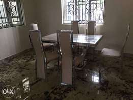 Marble Dinning with six chairs for sale.