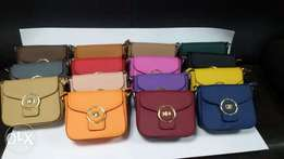 Fashion trending ladies hand bags,sling bags and clutch bags