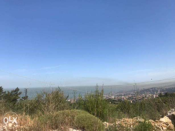 A 1300 m2 land with an open mountain view for sale in Roumieh