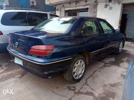 A clean and neatly used 2000 Peugeot 406, auto gear, ac chilling, cd.
