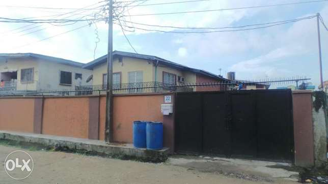 A Storey Building for Sale in Ijesha Surulere with C of O Moudi - image 1
