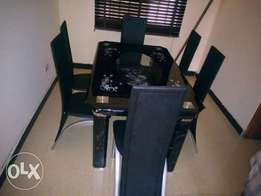 brand new glass dining with chairs
