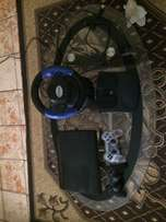 ps3 console 18 games 2 controller steering wheel charger and all cable