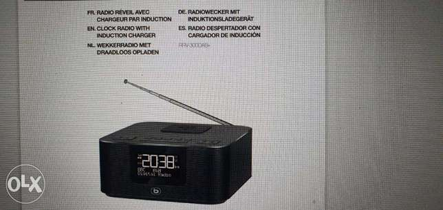 Clock radio with induction charger for smartphone