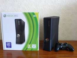 X Box 360 with 1 remote and 4games