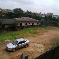 Building for sale in akute olori on a plot plus 13million