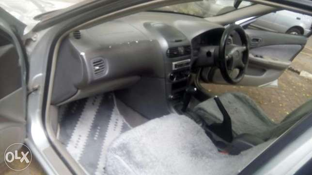Selling Above Nissan Sunny B15, KAX 680B,Silver in Colour,Very Clean Langata - image 4