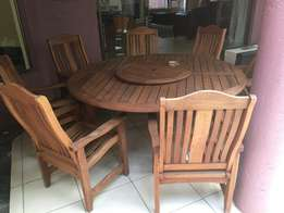 Wood 8 seater round patio dining set from Patio Warehouse