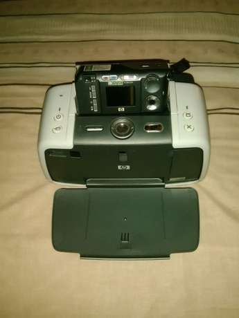 Camera + printer + battery charger Kloof - image 1