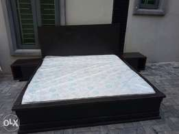 A 6x6 bed with a 2 side drawers and a mattress