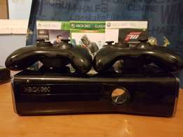 XBox 360 Console with 2 controllers and 4 games