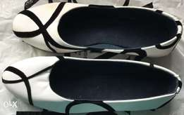 New white ladies flats shoes  with black print design size 7