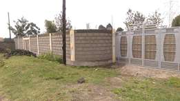 1/4 plot for sale with perimeter wall in Mwariki.