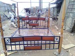 6 by 6 Metallic bed With wooden Legs