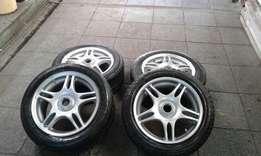 15 rims with tyres for mazda or ford 114x4 R2500 neg