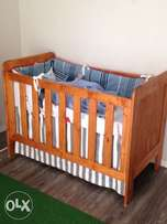 Beautiful wooden cot including mattress and cot skirt