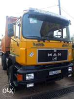 MAN ten tyres tipper truck with auxiliary 6x6