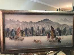 Panoramic painting of seaside city and sail boats