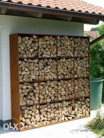 Wooden shelves for firewood by V&F wood decors