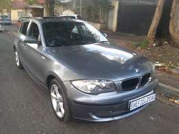 BMW 118i, 2009 model, Grey in color with a sunroof for sale
