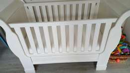 almost brandy new baby cot with matress