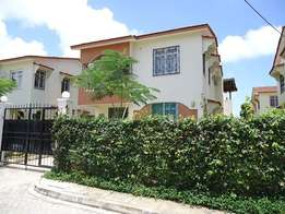 Modern spacious 4 bedroom MANSION in a gated community