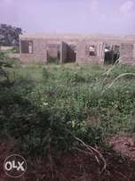 A plot of Land and 3bedroom uncompleted building for sale