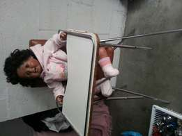 Old vintage baby high chair and large porcelaine doll.