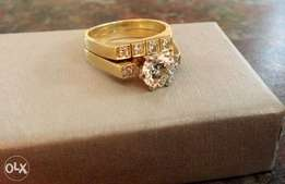 One 18ct gold engagement ring and wedding band set