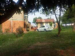 Prime land and a small house in kisaasi