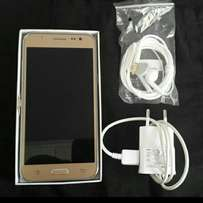 Samsung j5 dual sim charger & earphones inclusive free back cover