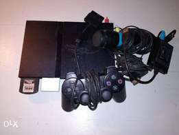 Broken PlayStation 2 plus accessories