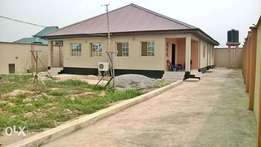 2 units of standard 2bed room on a full plot of land with CofO title