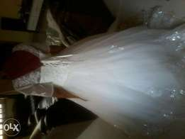 Wedding gown u.s. size 14 neat as new nd well bead.