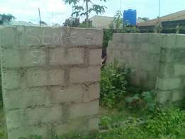 Uncompleted shops and land for sale