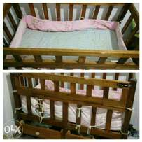 Baby cot with mattress.