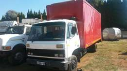 Nissan CM 10 , with box body,8 ton truck