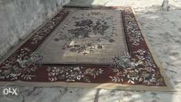 Used but very neat Woolen Carpet