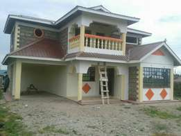 1/4 acre with a 5 bedroom house on sale authority tittle deed at 12M