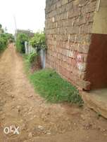 Land for sale in banana raini of 100 by100 touching tarmac