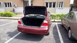 Red 2006 Toyota Camry LE. Superclean!