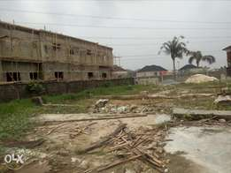 One plot of land at thomas Estate with deed of Assignment.